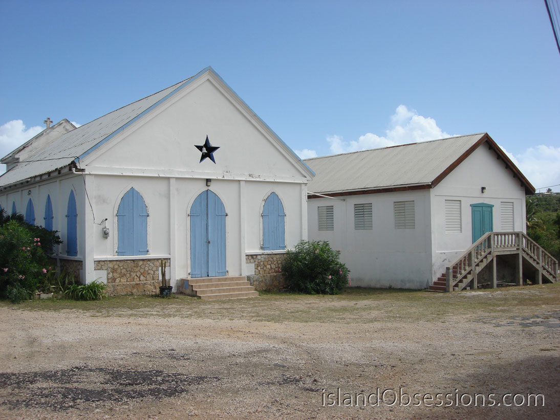 Turn at this Anglican Church in Island Harbor onto Rupert Phillip Rd to get to R&R Services Laundromat