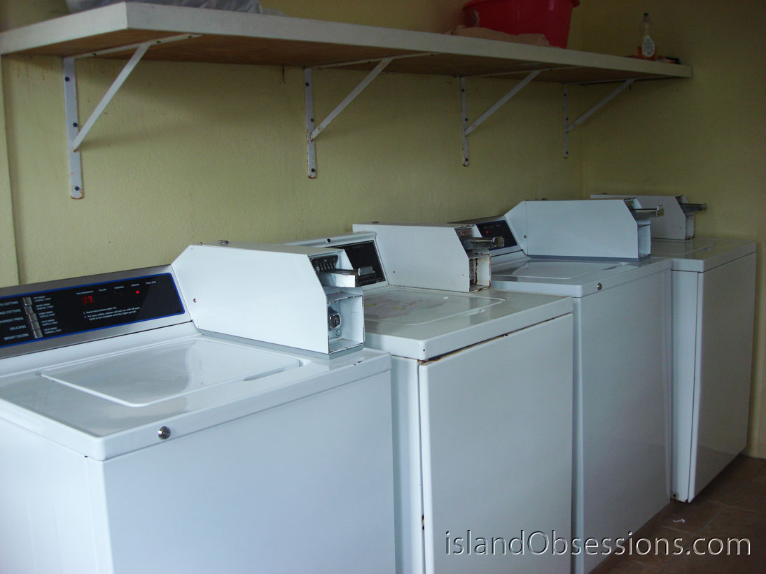 Four washers inside the Tackling Apartments Laundromat
