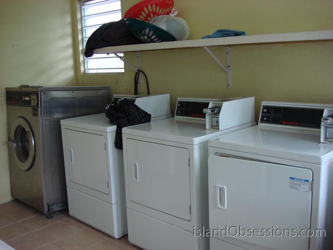 Five Dryers Inside the Laundromat at Tackling Apartments (one not pictured)